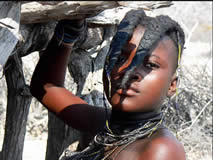 Joven pastor Himba.: Botswana, Namibia, Cataratas Victoria, Sudáfrica
